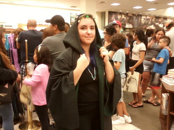 Slytherin staff helping keep queue in order